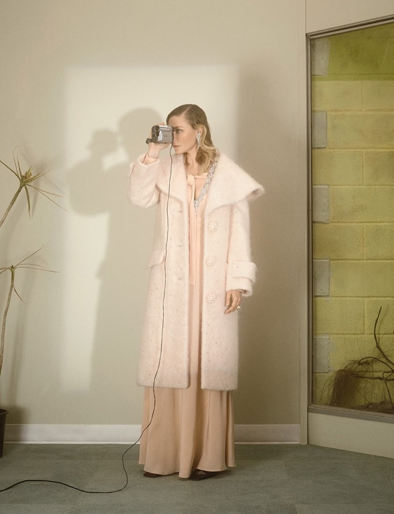 Looking pretty in pink, Kirsten Dunst poses in Miu Miu coat and dress with Gillian Horsup earrings