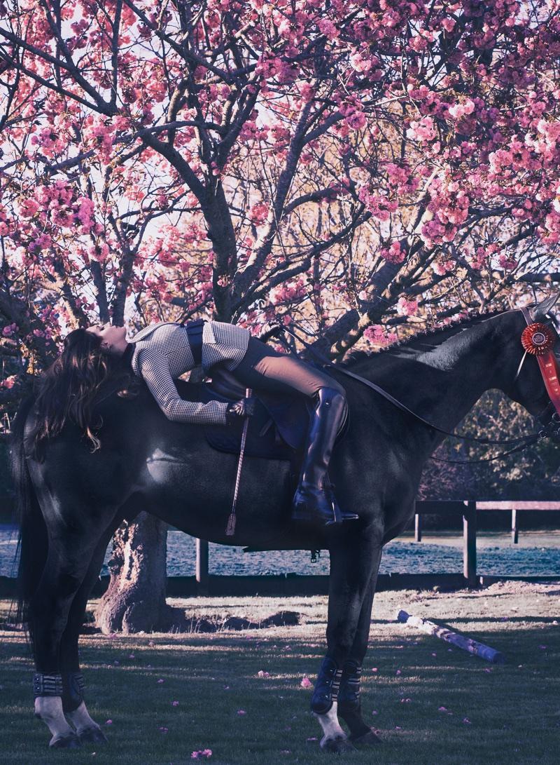 Posing on a horse, Lana Del Rey wears Altuzarra jacket, Vince pants and FRYE boots