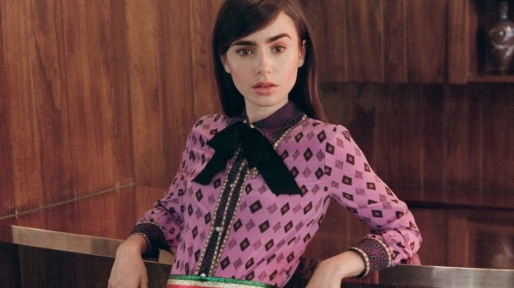 Embracing print, Lily Collins poses in Gucci blouse with Gucci pleated midi skirt