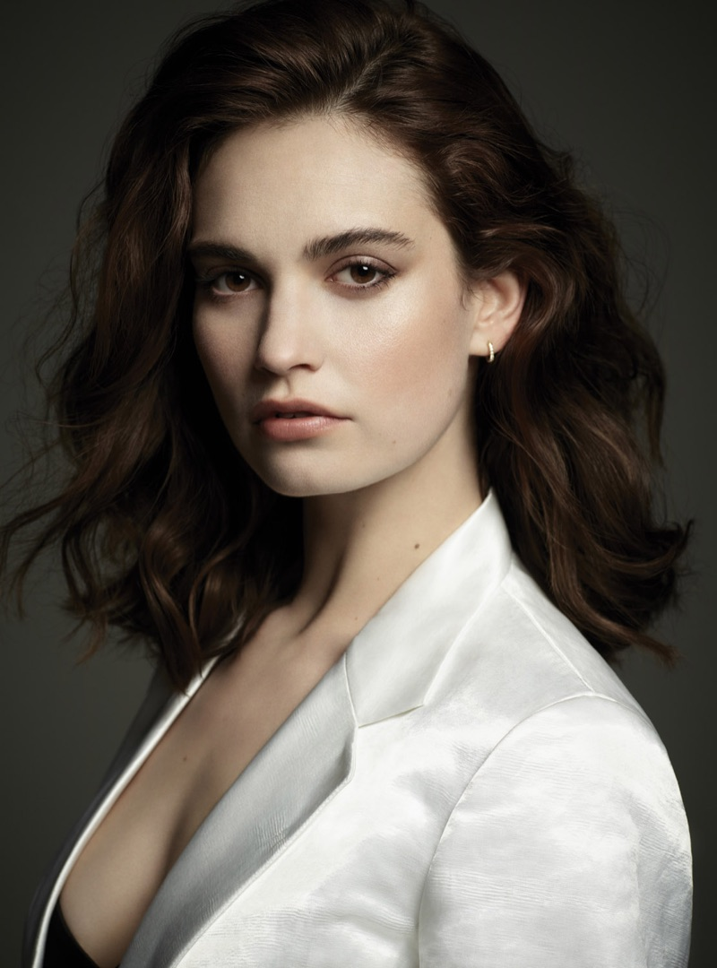 Getting her closeup, Lily James wears Victoria Beckham jacket and De Beers earrings
