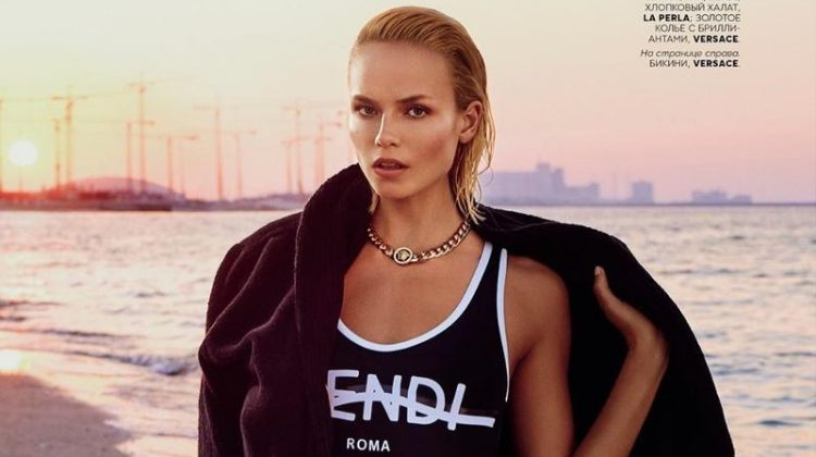 Model Natasha Poly wears beach style in the fashion editorial