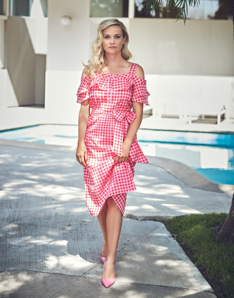 Looking pretty in pink, Reese Witherspoon wears Draper James gingham dress and Gianvito Rossi heels