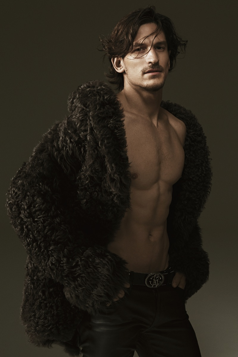 Jarrod Scott wears a fur coat in Roberto Cavalli's fall-winter 2017 campaign