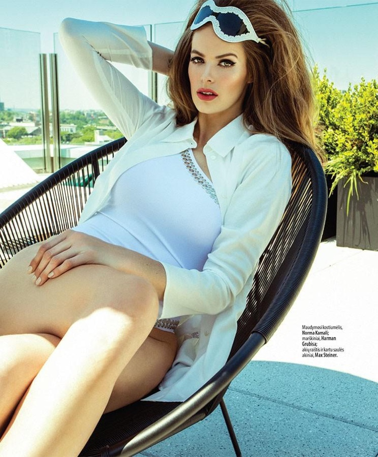 Model Robyn Lawley poses in poolside style for the fashion editorial