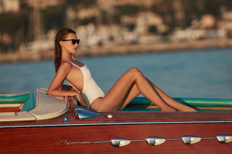 Magdalena Frackowiak wears white one-piece swimsuit from Solid & Striped