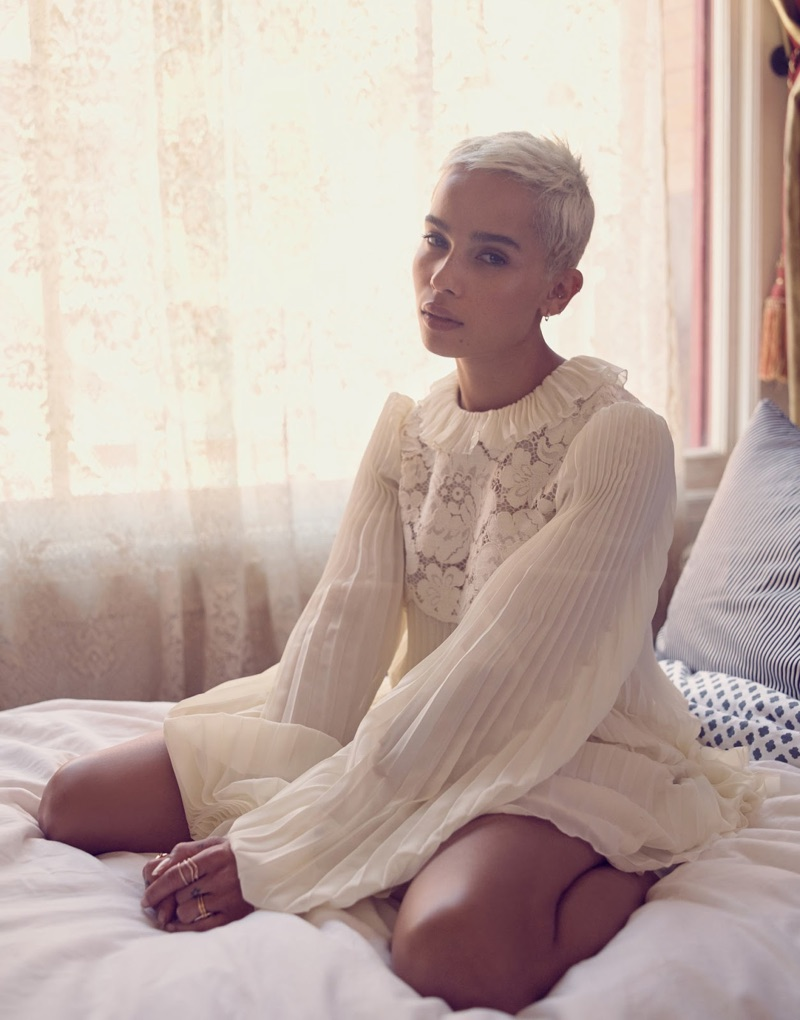 Posing in bed, Zoe Kravitz wears Philosophy Di Lorenzo Serafini dress and Saskia Diez earrings