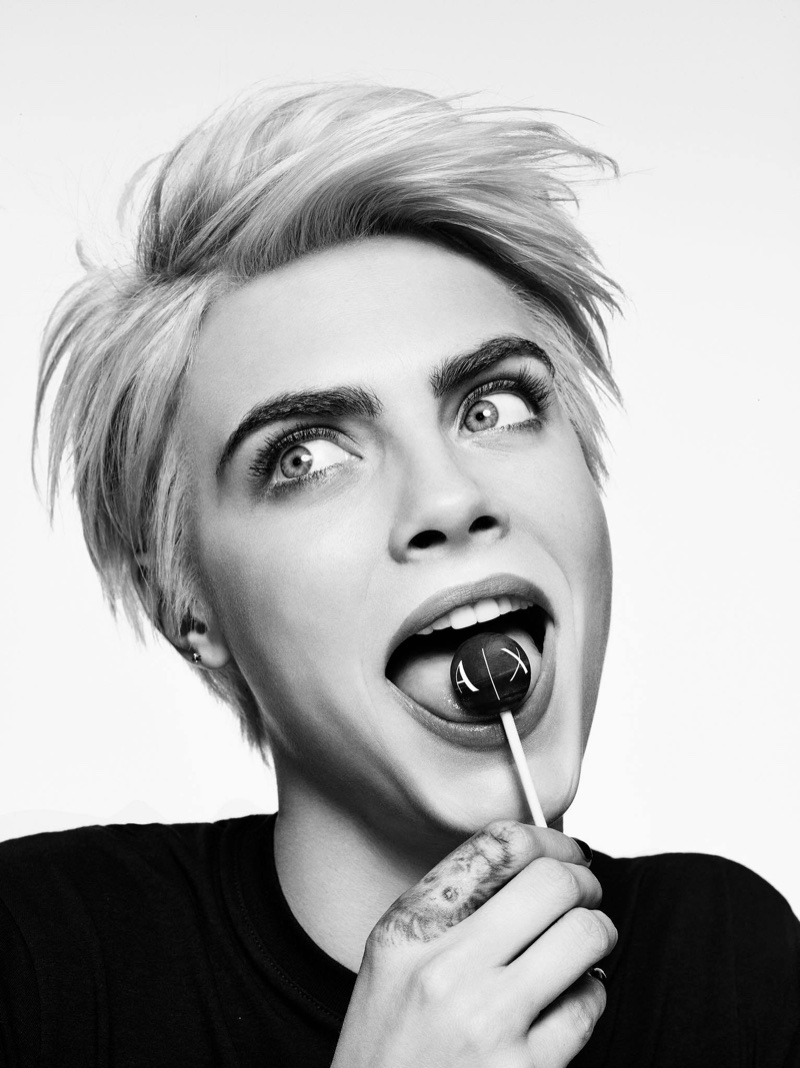 Cara Delevingne licks a lollipop in A|X Armani Exchange's fall-winter 2017 campaign