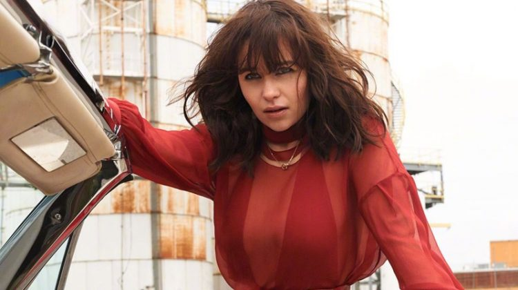 Actress Emilia Clarke poses in a red-hot look for the fashion shoot