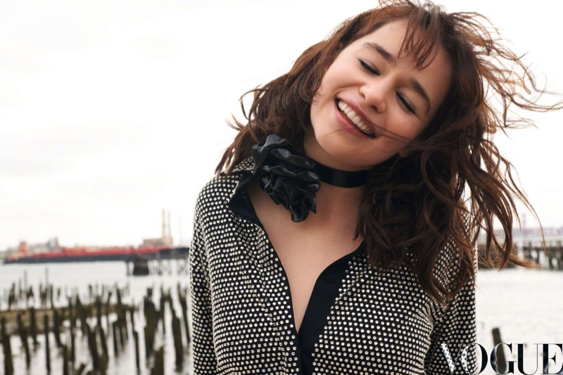 Emilia Clarke flashes a smile in this photograph