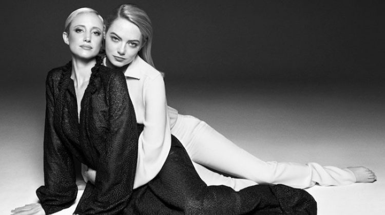 Andrea Riseborough wears Bonnie Young dress. Emma Stone models Tom Ford top and pants with Jennifer Fisher earrings.