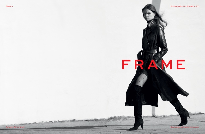 Photographed in black and white, Faretta poses in a leather trench coat from FRAME
