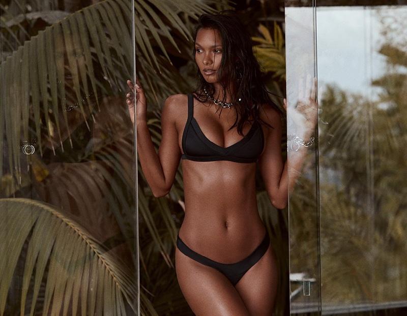 Lais Ribeiro models a black bikini from Fae Swimwear