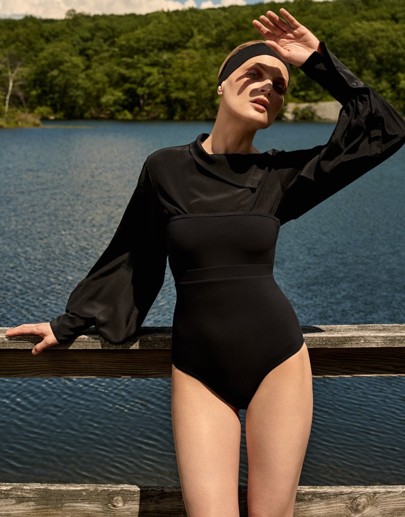 Guinevere van Seenus poses in Heidi Klein swimsuit and Bassike blouse