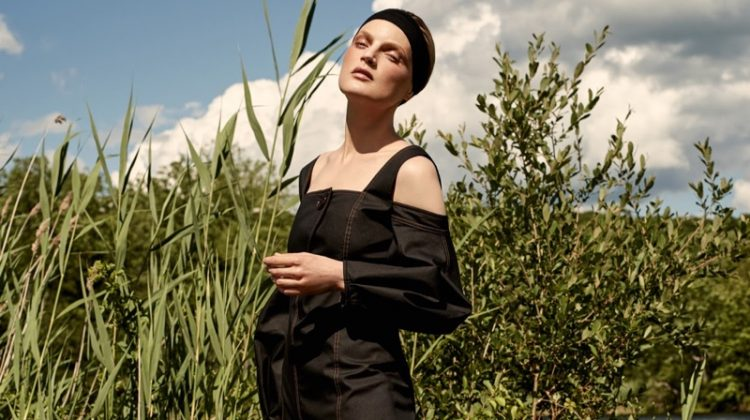 Model Guinevere van Seenus poses in Ellery cold-shoulder dress and The Row leather sandals