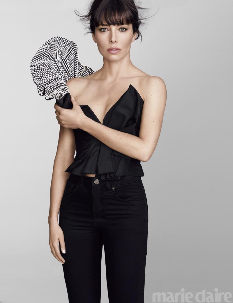 Jessica Biel poses in Saint Laurent top and jeans