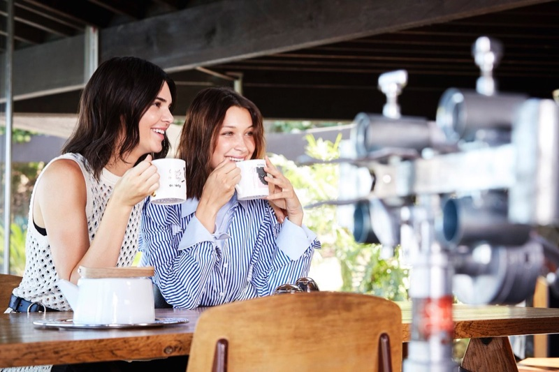 Bella Hadid and Kendall Jenner share a cup behind the scenes on Ochirly campaign