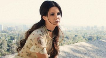 Singer Lana Del Rey poses in floral print dress from Coach