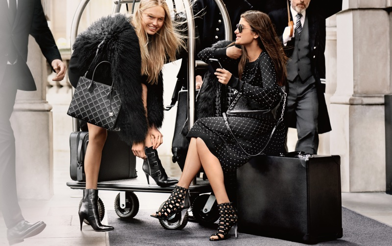 Romee Strijd and Taylor Hill pose in London for MICHAEL Michael Kors fall-winter 2017 campaign