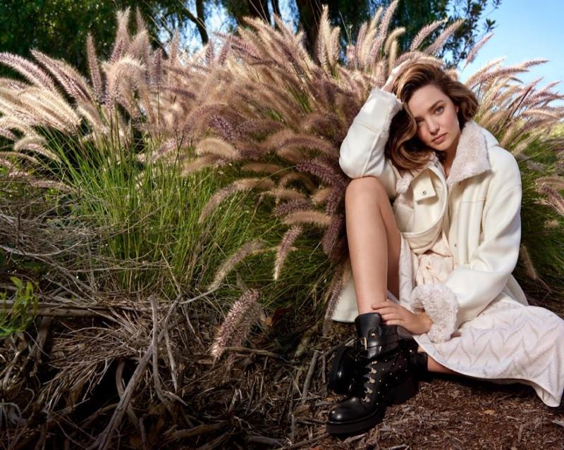 Model Miranda Kerr poses in Marella shearling jacket and heart print dress