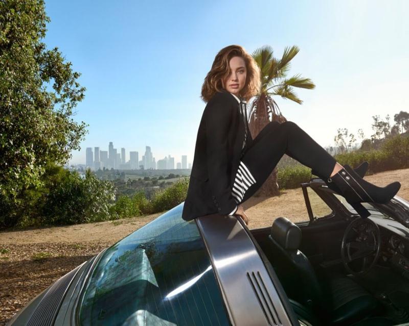 Miranda Kerr poses in a convertible wearing a Marella blazer, striped shirt and denim