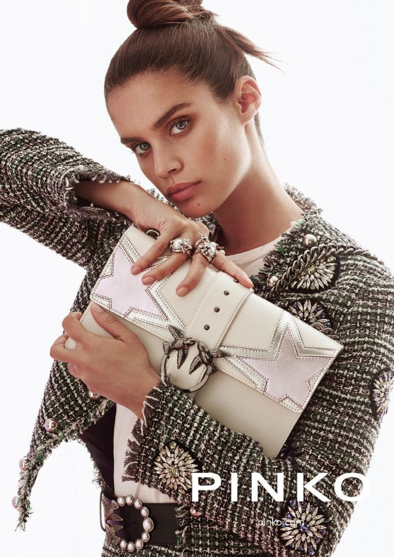 Sara Sampaio poses with a large clutch in Pinko's fall-winter 2017 campaign