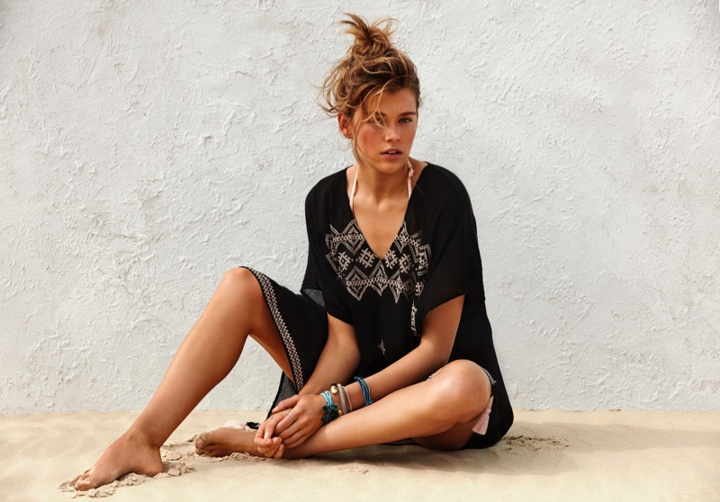 Victoria Lee models an embroidered caftan from Seafolly