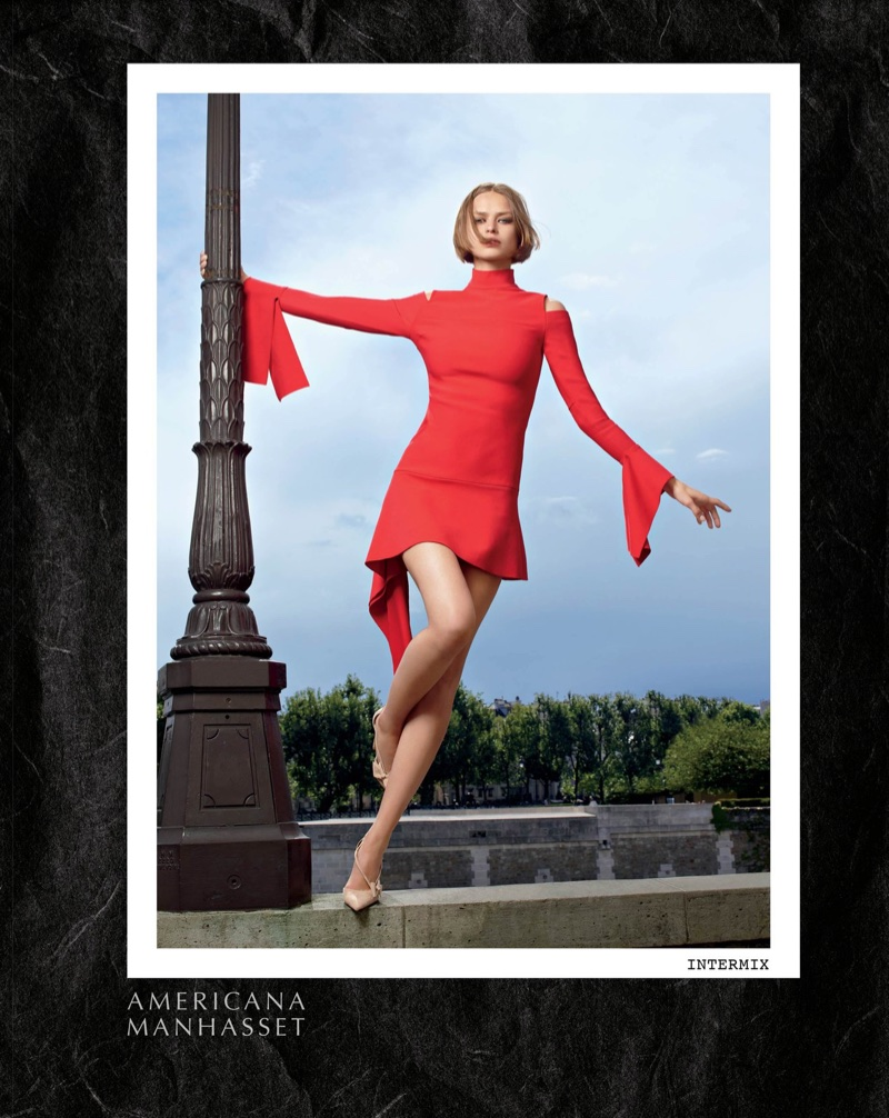 Birgit Kos poses in Intermix red dress for Americana Manhasset's fall-winter 2017 campaign