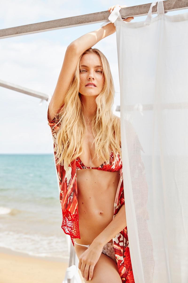 Caroline Trentini poses at the beach for Agua de Coco's spring-summer 2018 campaign
