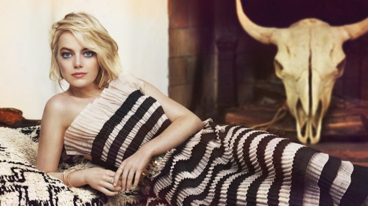 Lounging in style, Emma Stone wears striped Chanel dress