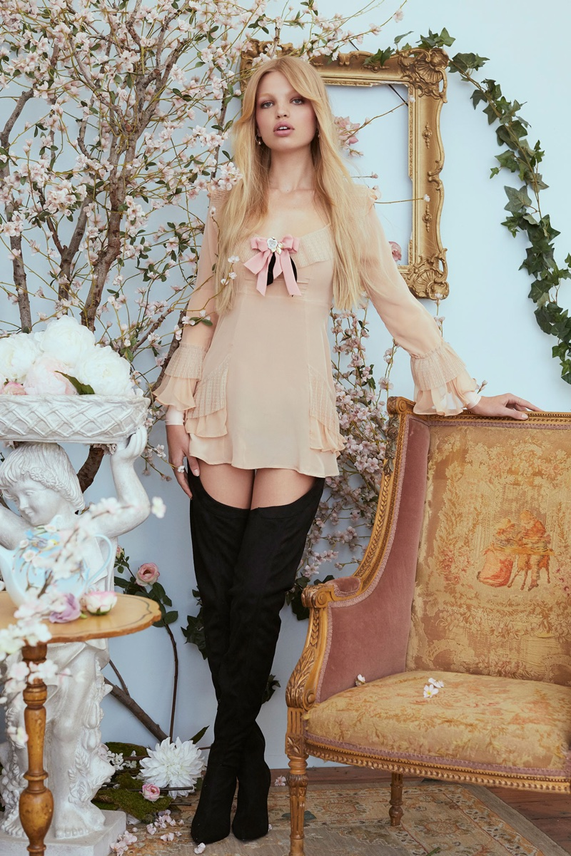 Model Daphne Groeneveld poses in For Love & Lemons Evie mini dress