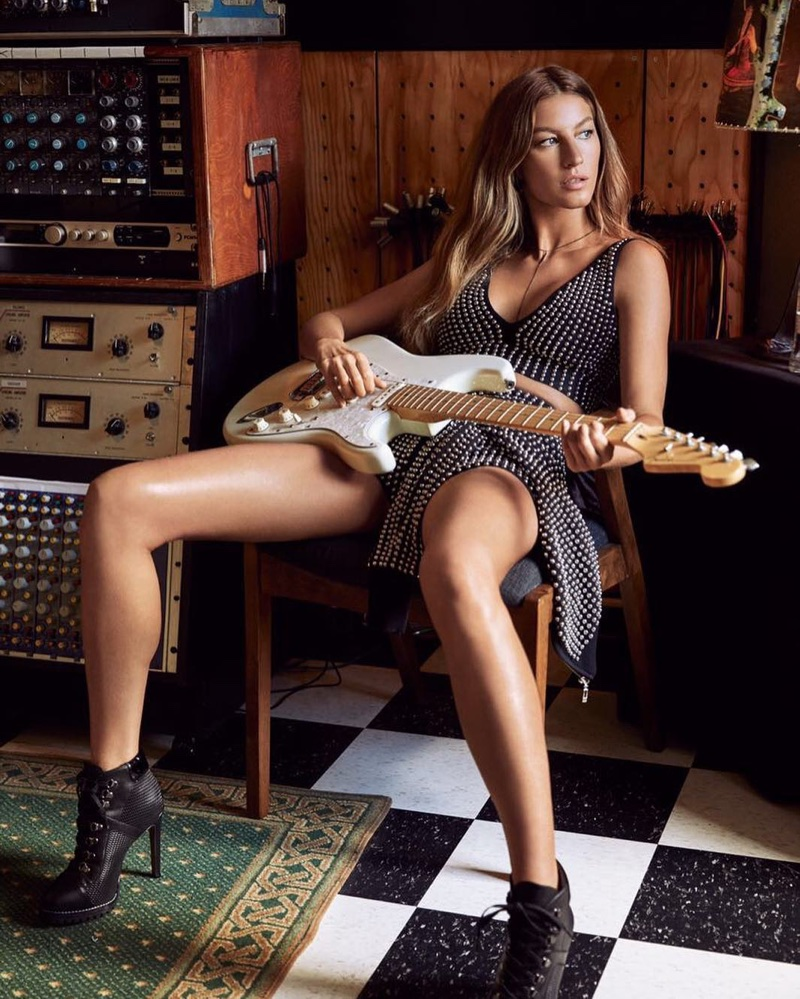 Gisele Bundchen poses with a guitar for Rosa Cha's spring-summer 2018 campaign