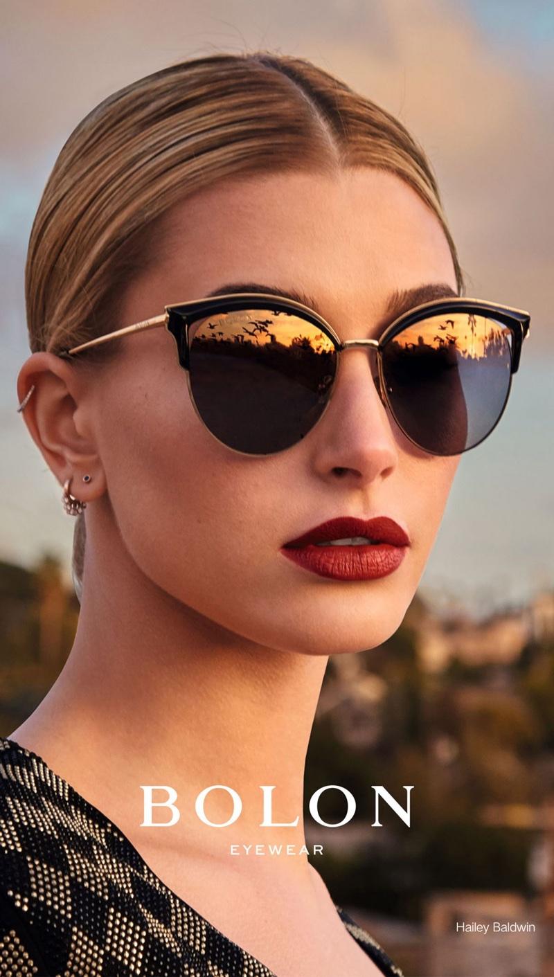 Model Hailey Baldwin wears cat eye sunglasses in Bolon Eyewear campaign