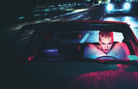 Posing in a car, Katy Perry wears Miu Miu stole