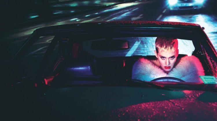 Posing in a car, Katy Perry wears Miu Miu stole