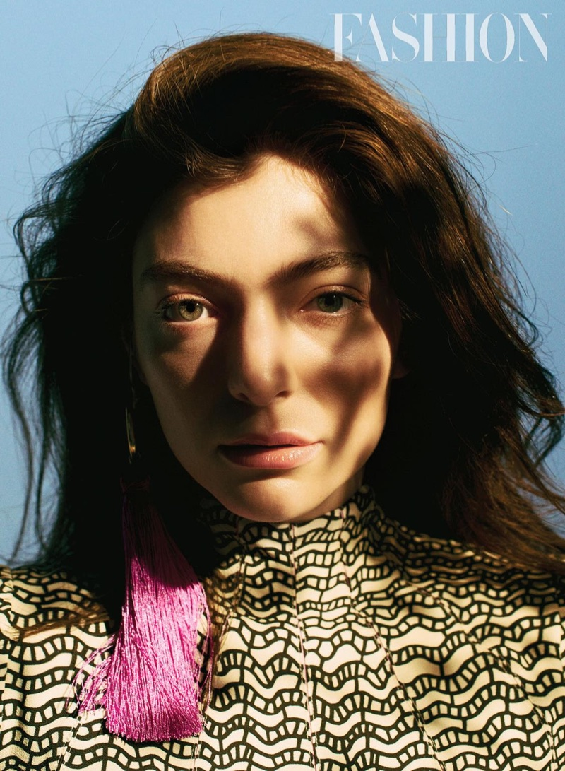 Getting her closeup, Lorde wears Valentino dress and Haarstick Jewelry earrings