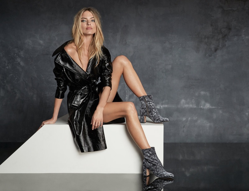 Model Martha Hunt flaunts her legs in Marc Fisher ankle boots