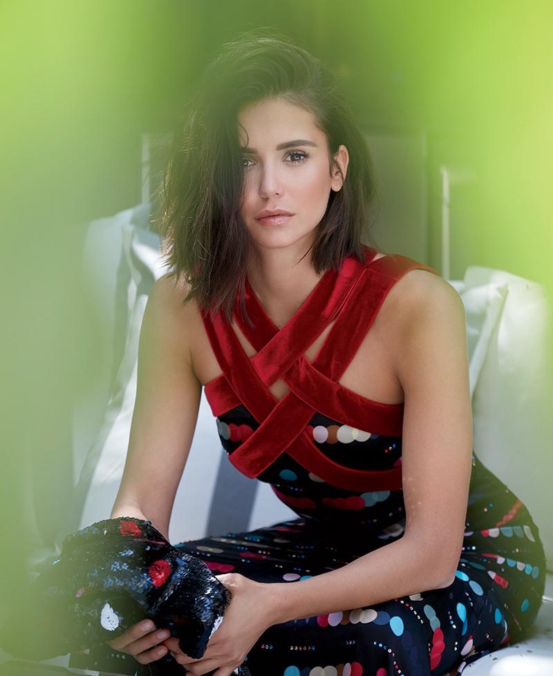 Nina Dobrev poses in Emporio Armani sequined print dress
