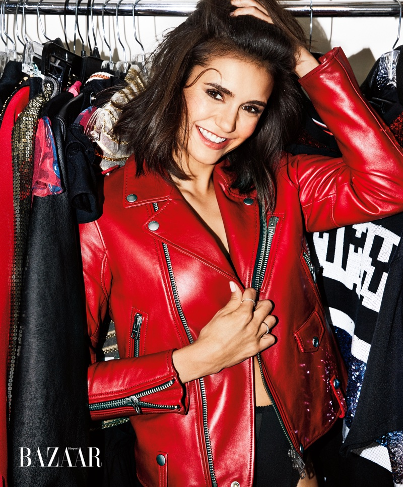 Actress Nina Dobrev is all smiles in Coach 1941 leather jacket