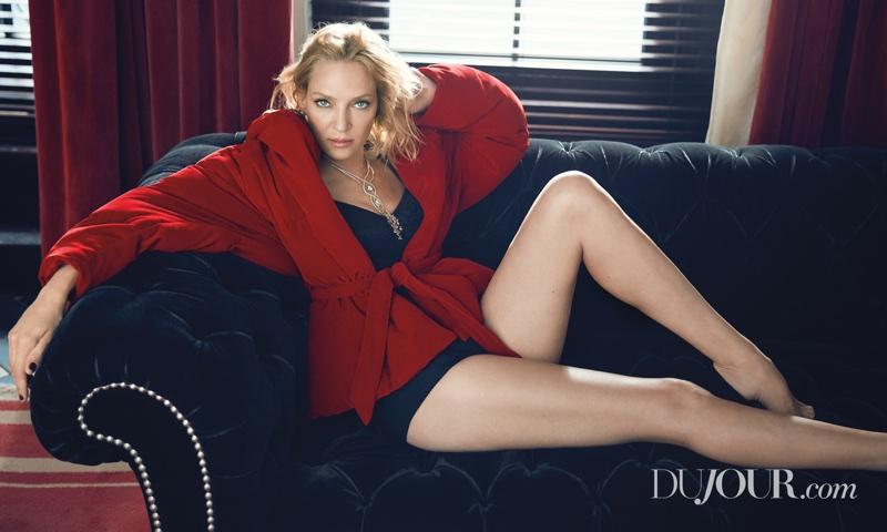 Uma Thurman wears Dolce & Gabbana bodysuit and Alexandre Vauthier coat with Stuart Weitzman shoes