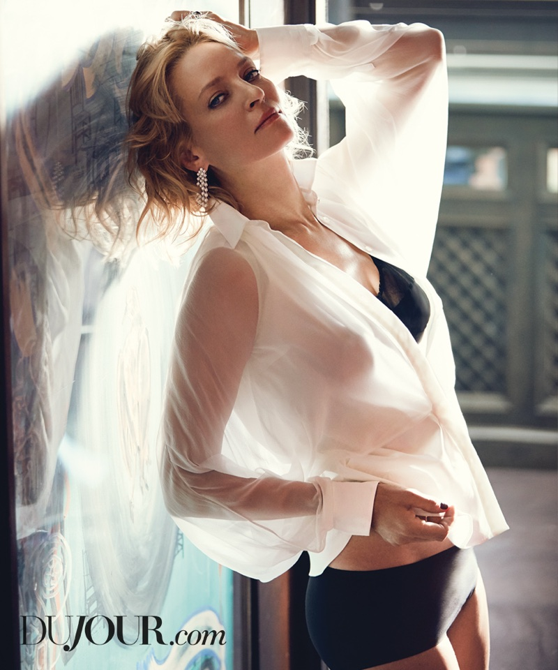 Actress Uma Thurman poses in Araks bra, Brunello Cucinelli shirt and Van Cleef & Arpels earrings