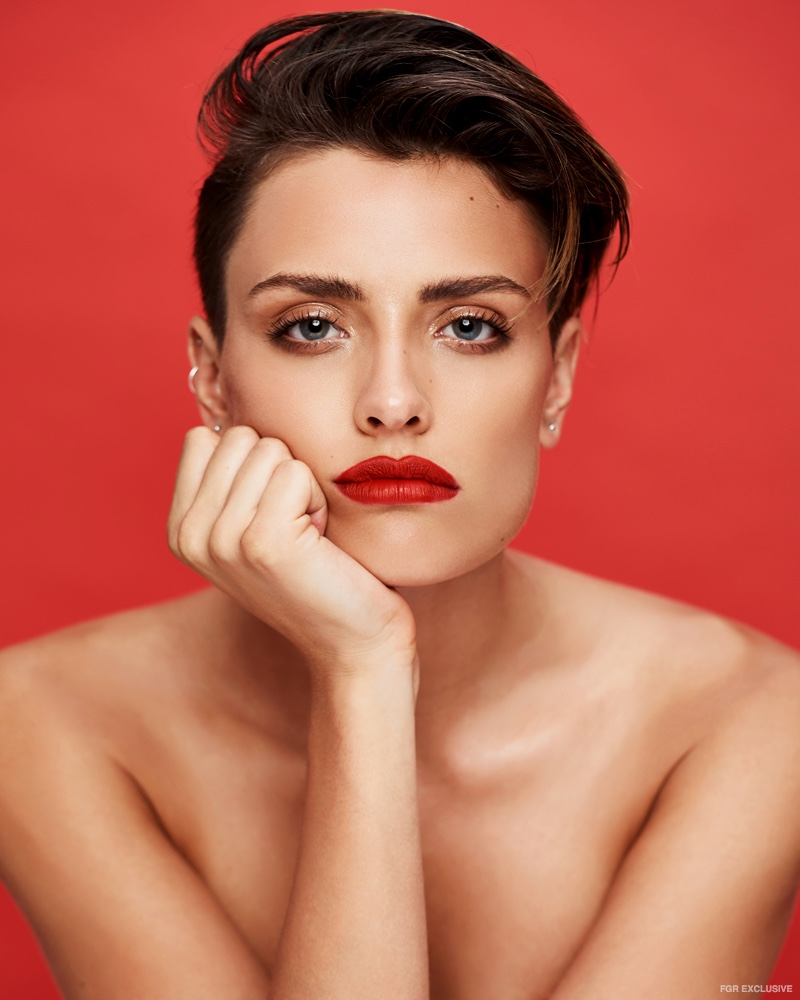Actress Wallis Day shows off a bold red lipstick shade