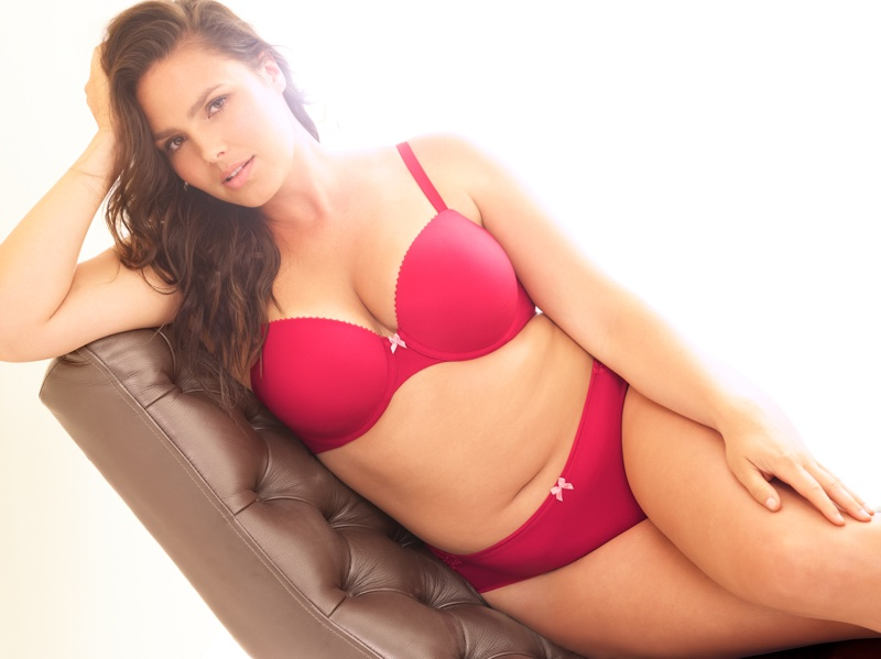 Candice Huffine models hot pink bra and underwear from Torrid Curve