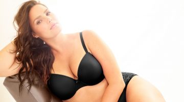 Model Candice Huffine poses in black lingerie for Torrid Curve campaign