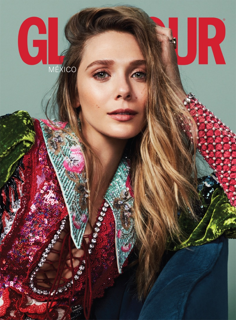 Actress Elizabeth Olsen wears a multicolored jacket