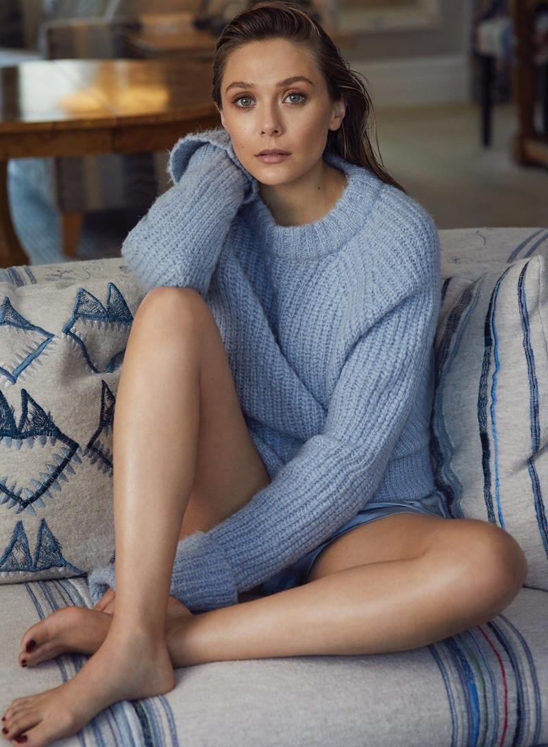Elizabeth Olsen poses in FRAME sweater and Olivia von Halle shorts