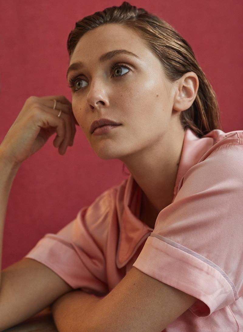 Getting her closeup, Elizabeth Olsen poses in Araks pajama top and Messika rings