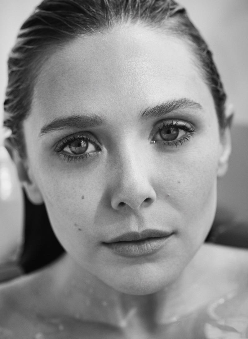 Photographed in black and white, Elizabeth Olsen wears a natural makeup look