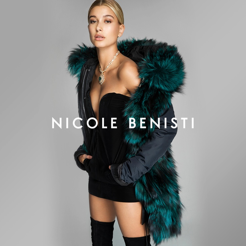 Model Hailey Baldwin poses in little black dress and faux fur in Nicole Benisti's fall-winter 2017 campaign