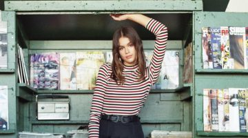 Kaia Gerber poses in striped top and miniskirt for Penshoppe's latest campaign