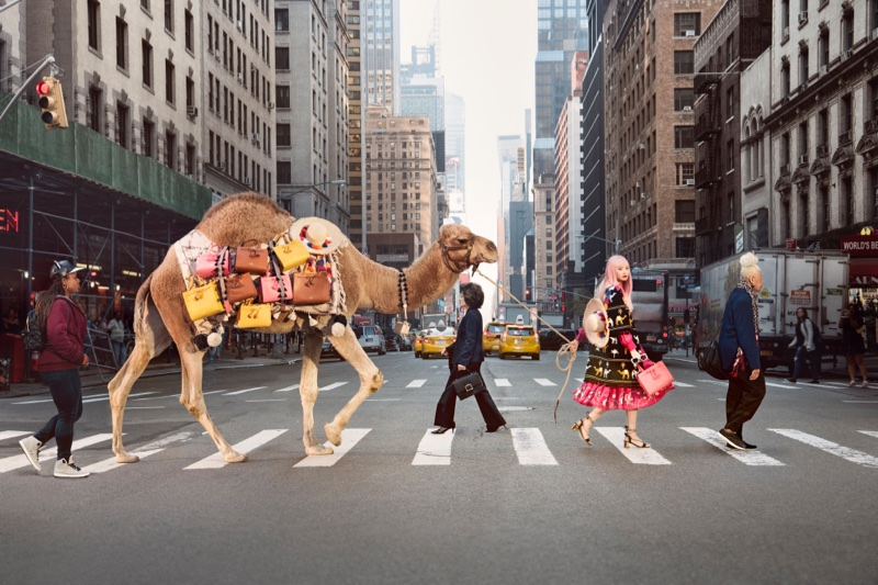 Fernanda Ly walks in New York with a camel for Kate Spade's spring-summer 2017 campaign